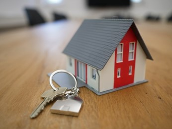 a keychain with a miniature house