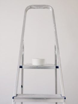 ladder with scotch tape on it